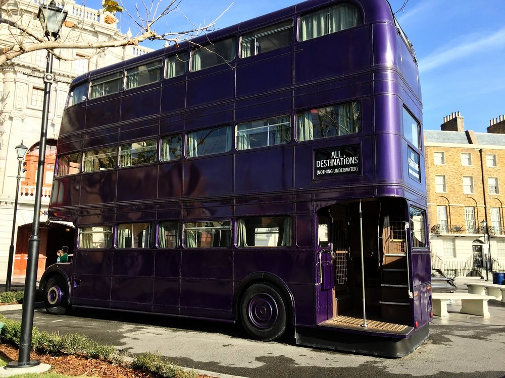 The triple-decker Knight Bus is in the London Waterfront area near the Eros Fountain.