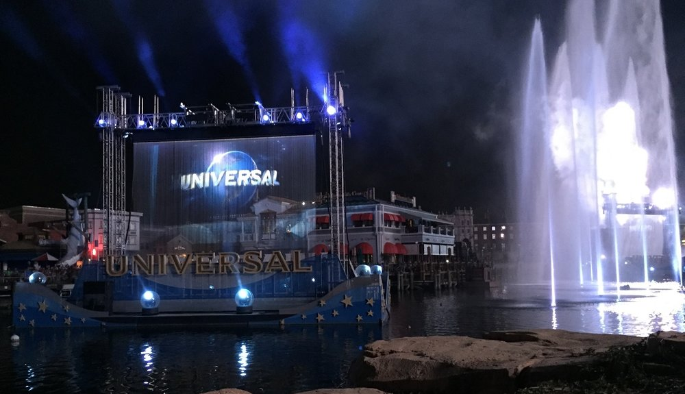 Images were projected on waterfall screens while fountains danced in the water and fireworks exploded in the air.