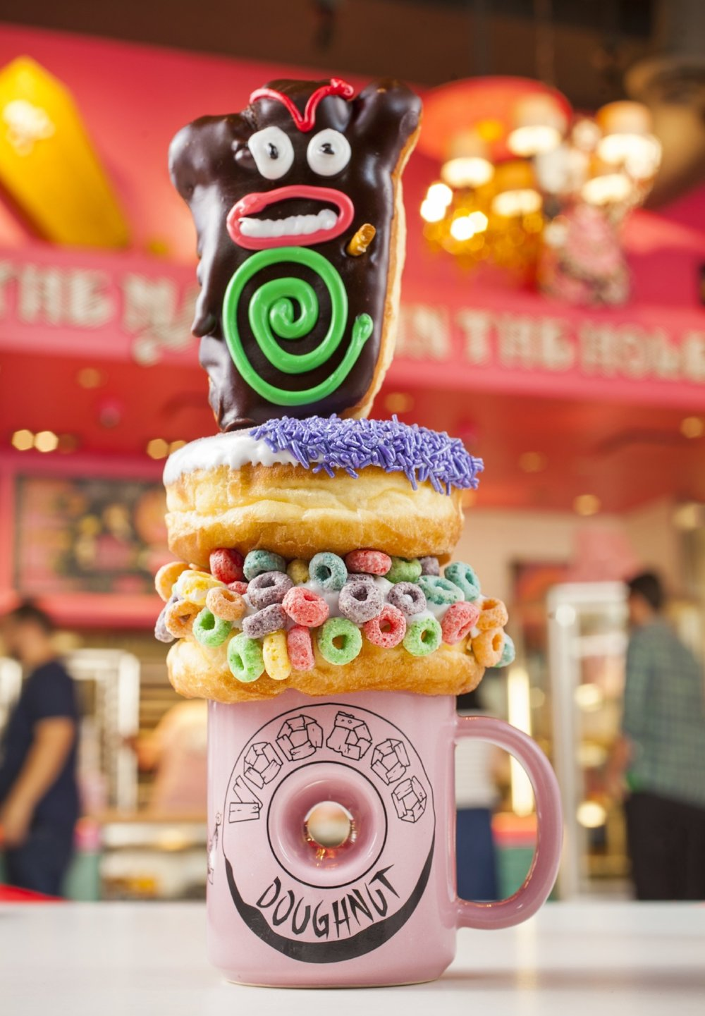 Voodoo Doll, Grape Ape, and The Loop doughnuts from Voodoo Doughnut. Copyright Universal Orlando Resort. All rights reserved.