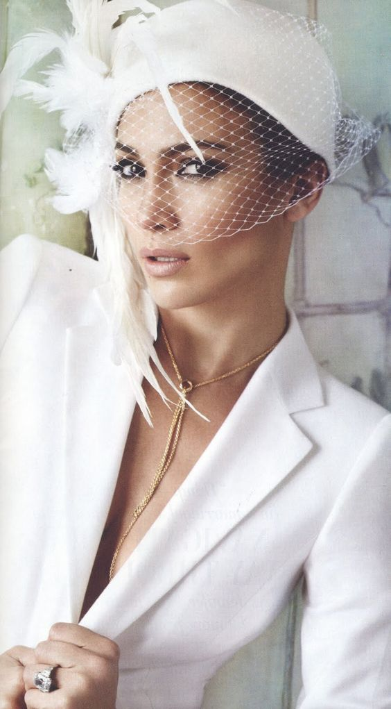 Christine A. Moore has been creating hats professionally for over twenty  years. Although Christine designs a wide range of hats f4e4c69618f