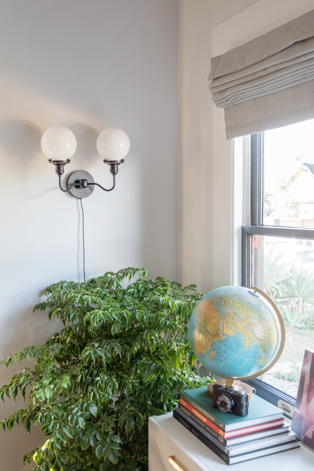 Pretty cord for wall-mounted light fixture instead of hiding it
