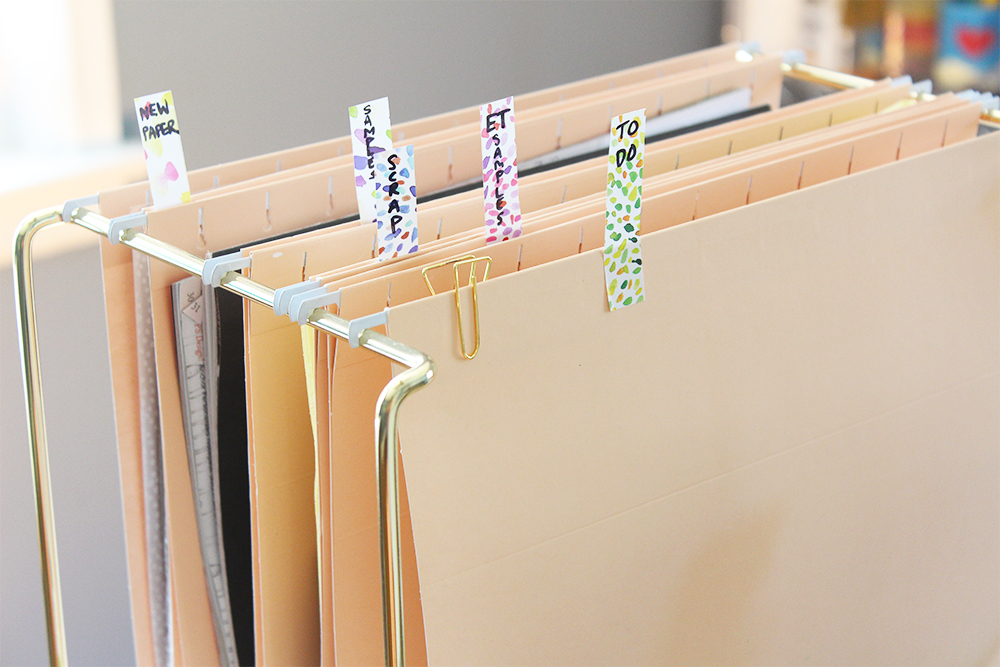 I love the way this file rack looks -- although I can't say it actually helps me much with organization as I tend to pile things in haphazardly!