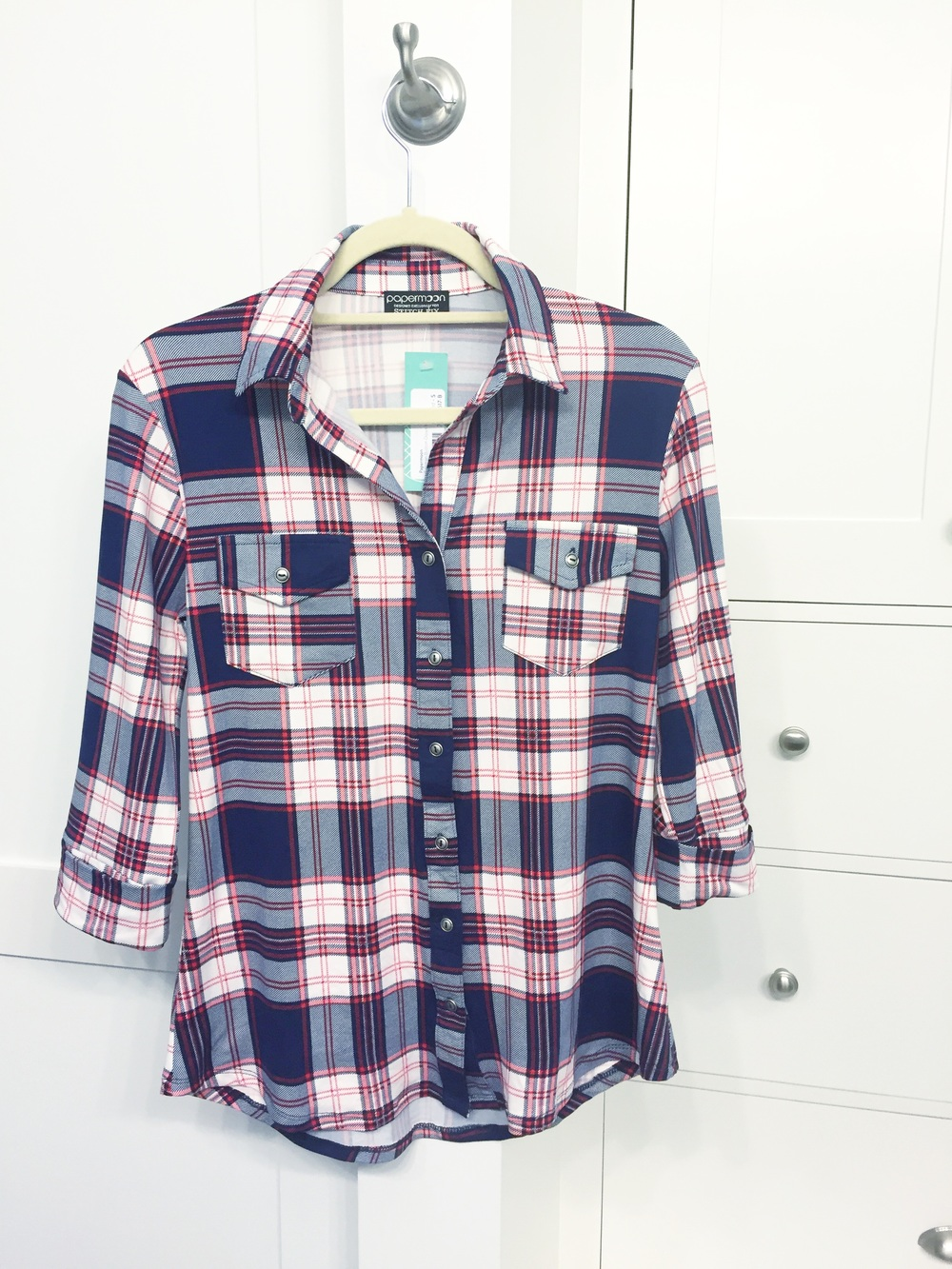$54 plaid shirt - This pop of plaid initially had me really excited, but I was disappointed when I pulled it out of the box. I love cotton and flannel plaid shirts, but this one is polyester. I am more of a gold girl, so I don't love the silver buttons. The pockets also give this a more of a Western flair than I'm comfortable with. RETURN