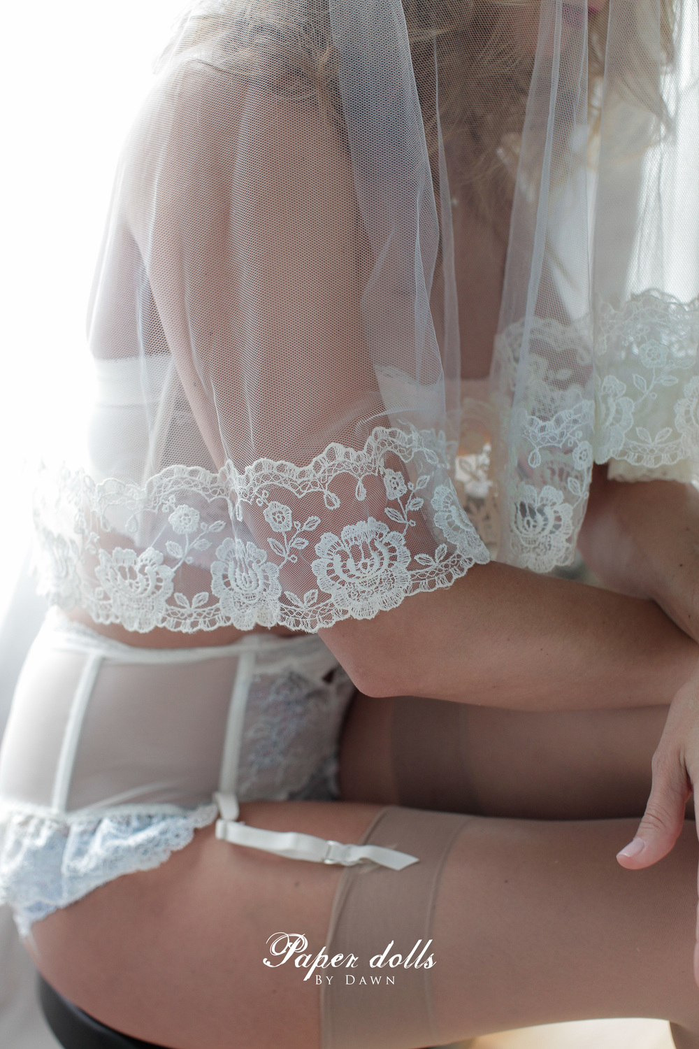 bridal boudoir pose wedding veil