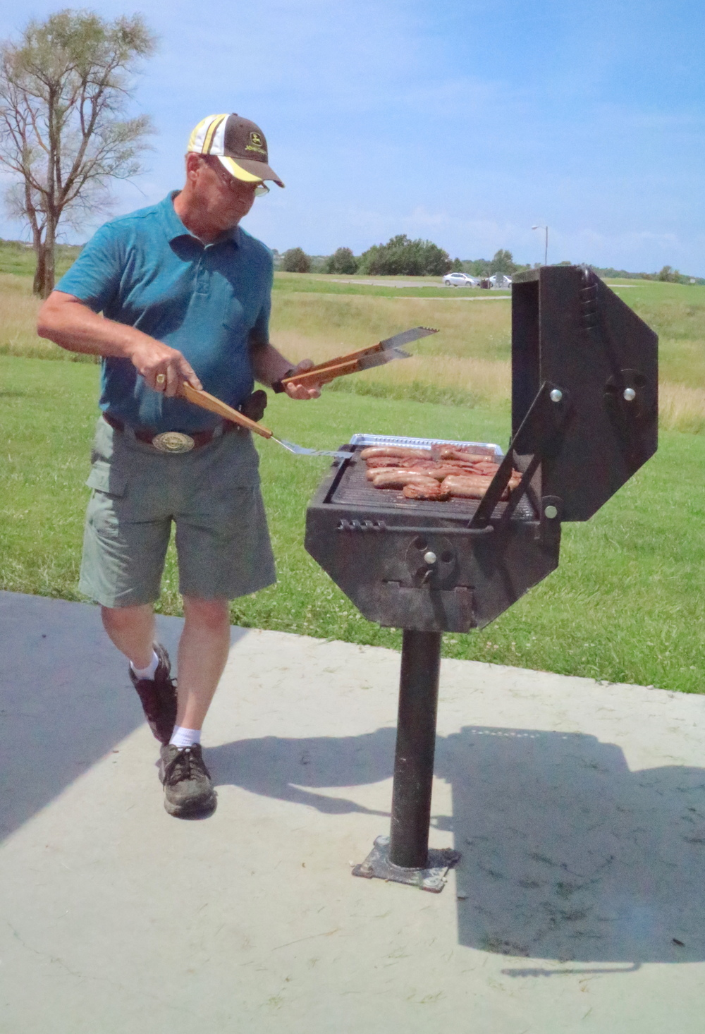 Grillmaster  Mike Kennedy  in action.  Mike  and  Nancy  hauled multiple huge coolers, BBQ supplies, tools, water, soda and brats and burgers!