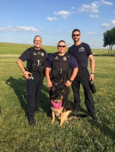 Armina  owned by  J.C. Gipe  wasn't going to be left out.  She wrangled a photo with the officers.