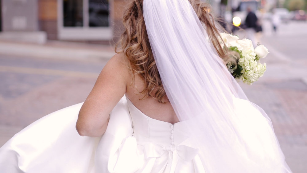 Bridal veil dress and bouquet