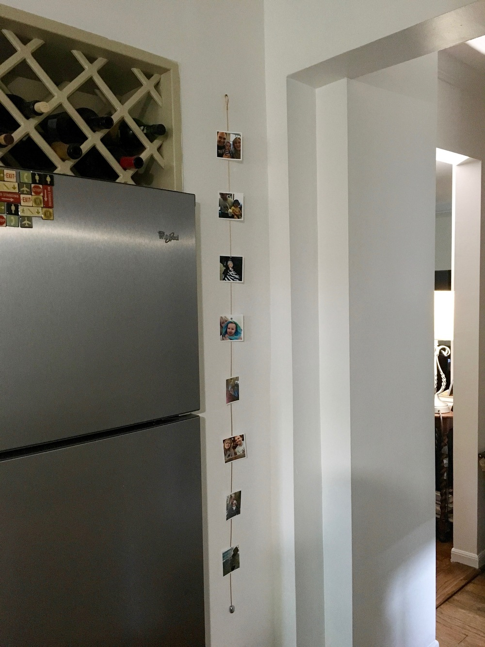 This is a little strip of awkward wall between the fridge and hallway.  We decided to utilize it for photos instead of cluttering the front of fridge.   (Please ignore the tan wine rack area--working to remove that asap).