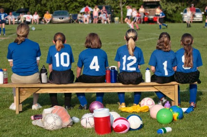 Girl soccer players on bench