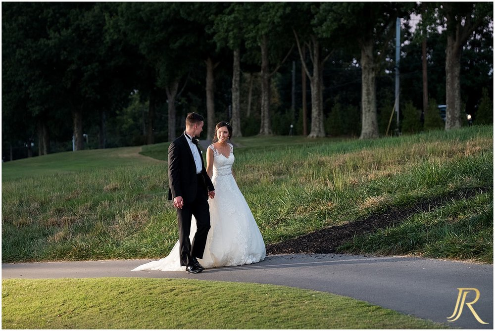 Bride and Groom enjoy a stroll on the golf course during their wedding at Cherokee County Club.