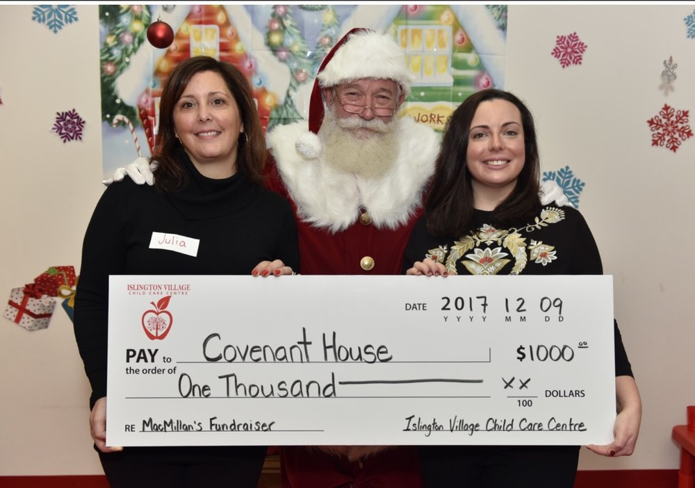 Islington Village Child Care Centre Director Julia Meffe, Santa Claus and Meghan from     Covenant House Toronto.