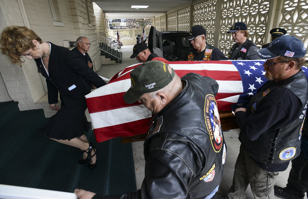 Patriot Guard Riders carry the remains of Army Pfc. William Butz into the Vancouver Funeral Chapel, Tuesday August 9, 2016. Butz, who was killed in the Korean War in 1950, was identified in April and his remains were flown from Oahu to his family in Clark County. (Ariane Kunze/The Columbian)