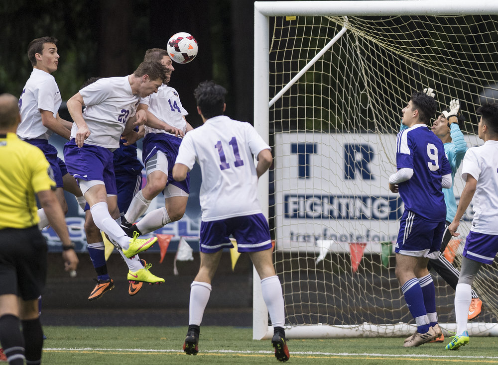 Columbia River's Ryan Connop (23), heads the ball into the goal in what was initially thought to be the fourth goal for Columbia River during overtime in the first round of the 2A state playoffs against Highline at the Kiggins Bowl in Vancouver, Tuesday May 16, 2017. (Ariane Kunze/The Columbian)