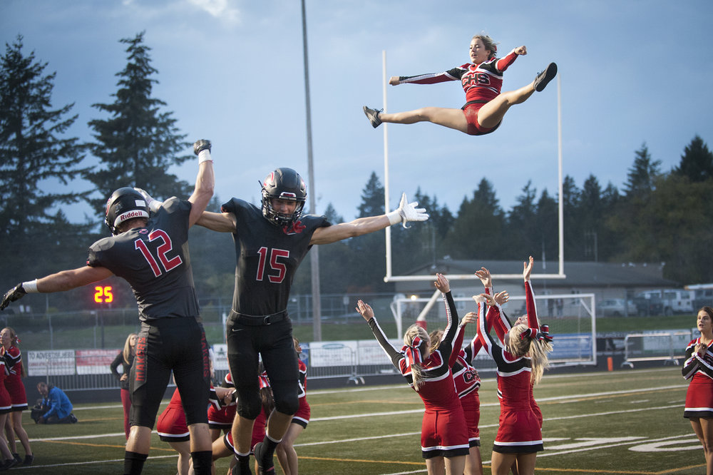 Camas' Michael Matthews (12) and Cooper McNatt (15) celebrate before the first quarter of the game against Battle Ground at Doc Harris Stadium in Camas, Friday September 30, 2016. (Ariane Kunze/The Columbian)