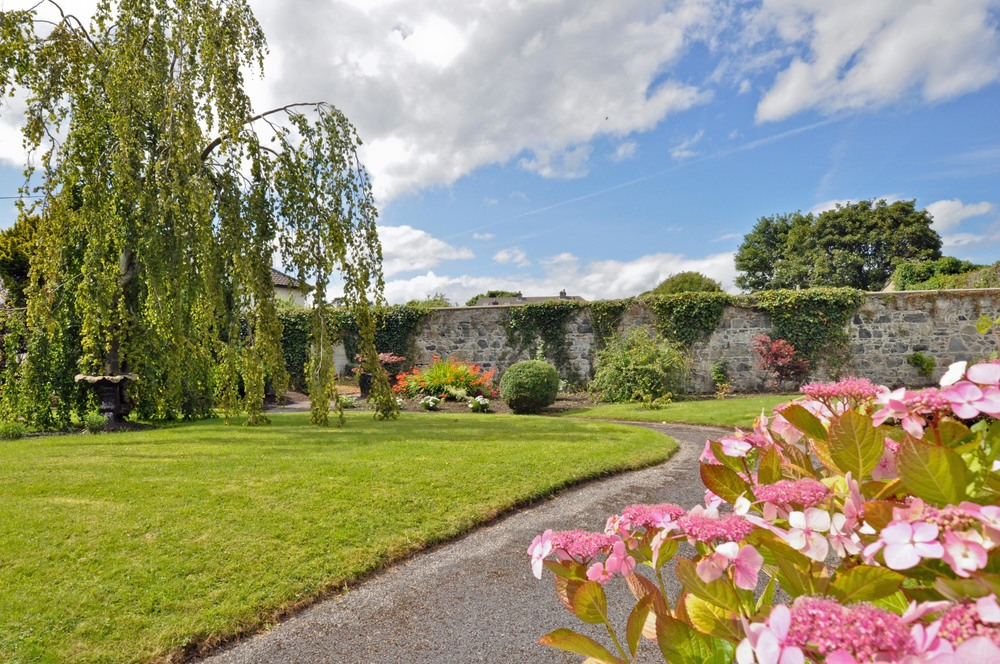 Stunning private, walled, landscaped gardens