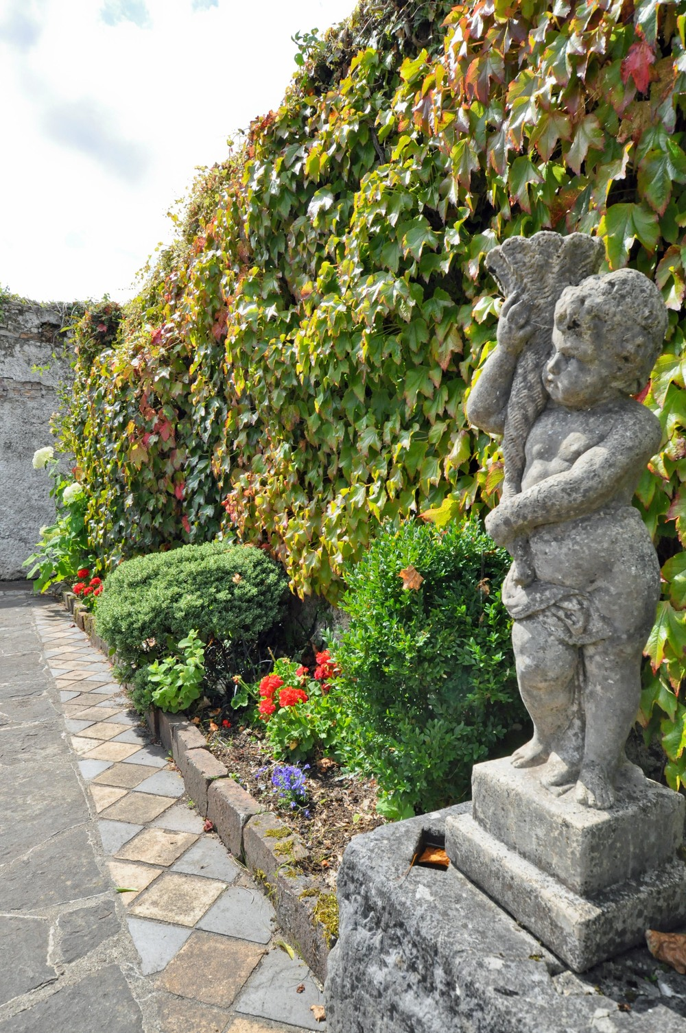 Antique figureen in the pivate outdoor eating area