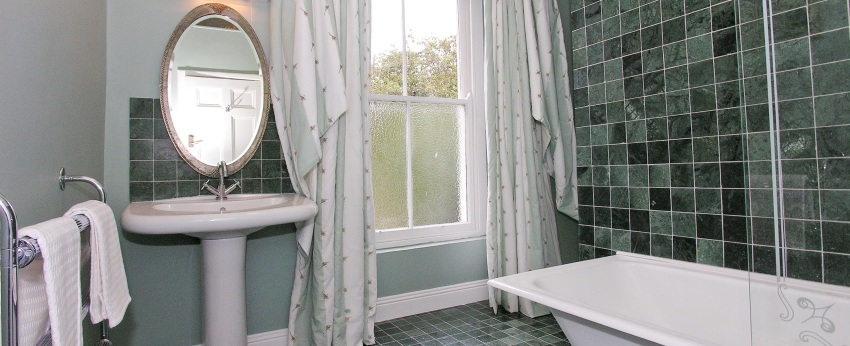 En-suite with power shower and deep bath