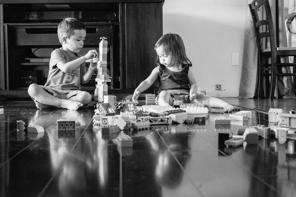 Children playing with Legos. Photo taken down low on the ground.