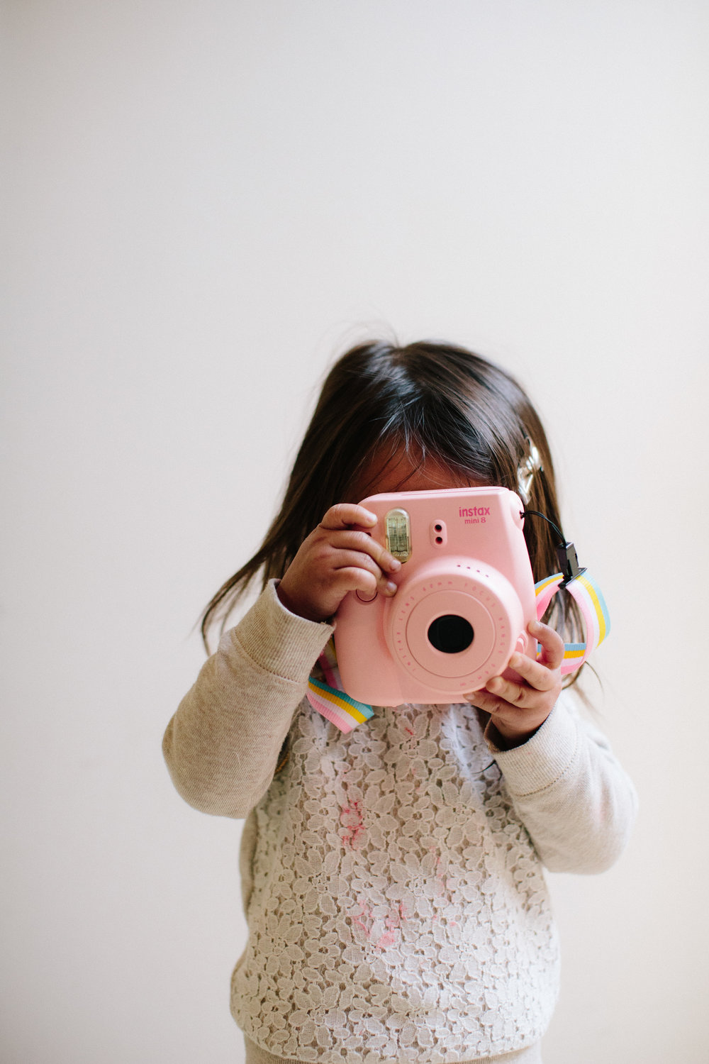She loves to hold her camera and in this rare moment, is holding it correctly. She usually holds it with the lens facing upward and shoots tons of selfies.