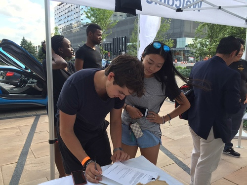 Drivers completing Barretto Bay's consumer preference survey at a BMW i3 Ride and Drive event, June 2016