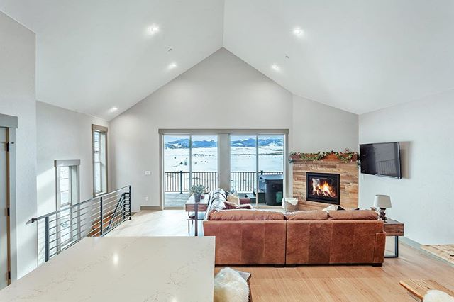 The open floor plan in this luxury vacation home feels perfect for reconnecting with family surrounded by natural beauty that Colorado is known for. . . . . . #royaloakbuilders #newbuild #luxuryrealestate #colorado  #interiordesign #staging #denver #granby @archdigest #architecturalphotography @recolorado