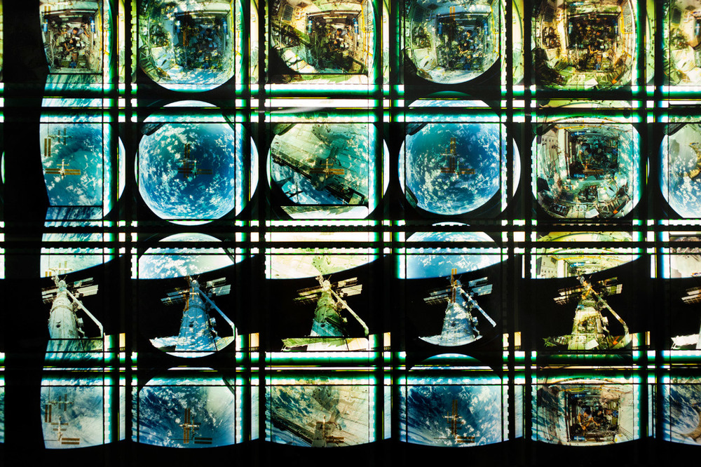 Space Program  . 65mm IMAX Celluloid Film,   Fluorescent Lights, Plexiglas,   Custom Lightbox. 40  x40  x6. Richard Kerr. 2014. (Detail).