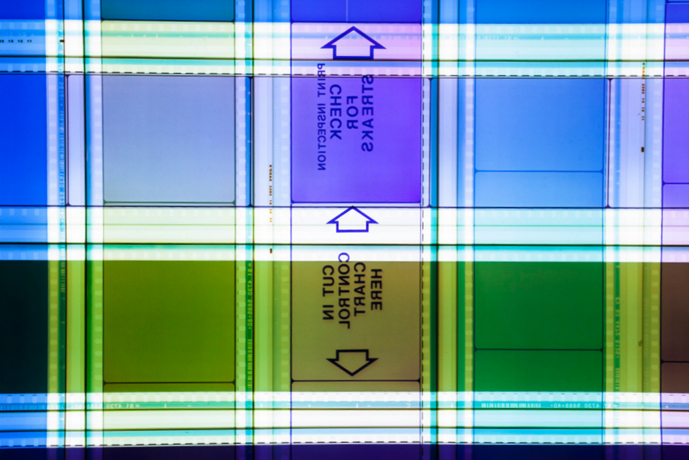 Print Inspection.  65  mm IMAX Celluloid Film, Fluorescent Lights, Plexiglas, Custom Lightbox. 52x26x6. Richard Kerr. 2014. (Detail).