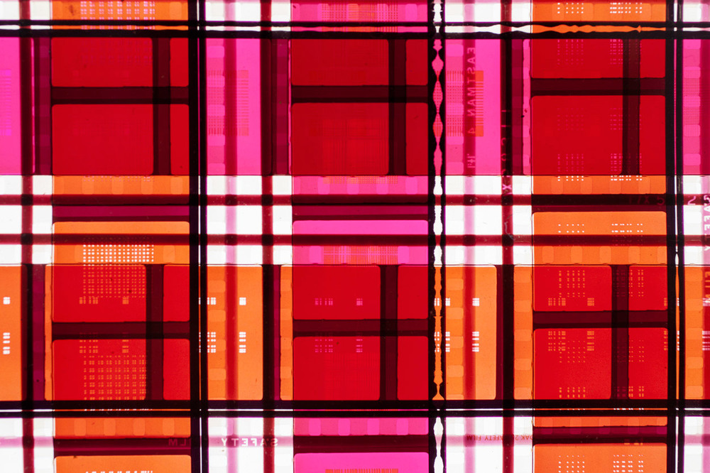 Mosaic (Red).   35mm Celluloid Film,   Fluorescent Lights, Plexiglas,   Custom Lightbox. 52x26x6. Richard Kerr. 2014. (Detail).