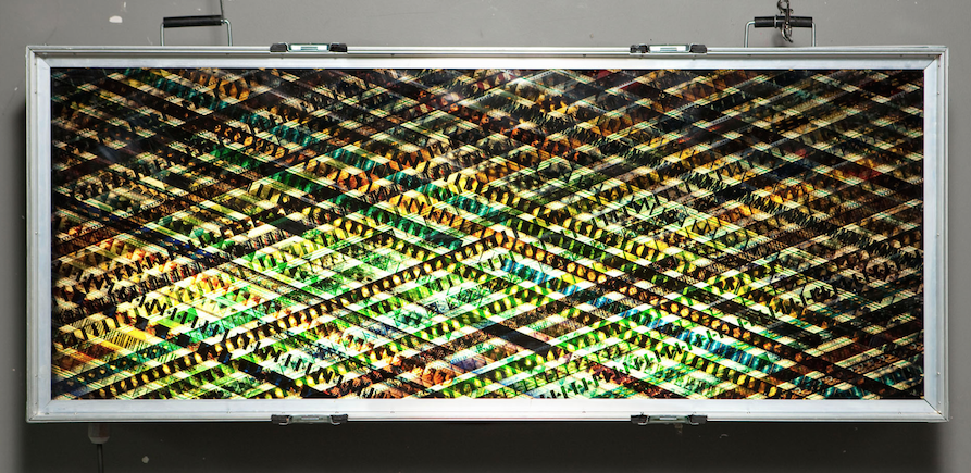 Behold The Message.  35mm Celluloid Film. Fluorescent Lights. Glass. Custom Lightbox. 60x30x8. Richard Kerr. 2004.  *Collected by TIFF Film Reference Library.