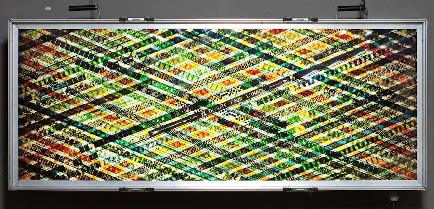 Hollywood Turns Light into Money.  35mm Celluloid Film. Fluorescent Lights. Glass. Custom Lightbox. 60x30x8. Richard Kerr. 2004.  *Collected by TIFF Film Reference Library.