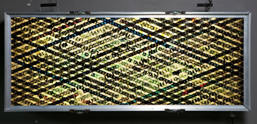 In Fear.  35mm Celluloid Film. Fluorescent Lights. Glass. Custom Lightbox. 60x30x8. Richard Kerr. 2004.  *Collected by TIFF Film Reference Library.