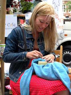 Mending a jumper at a Repair Cafe event in Amsterdam