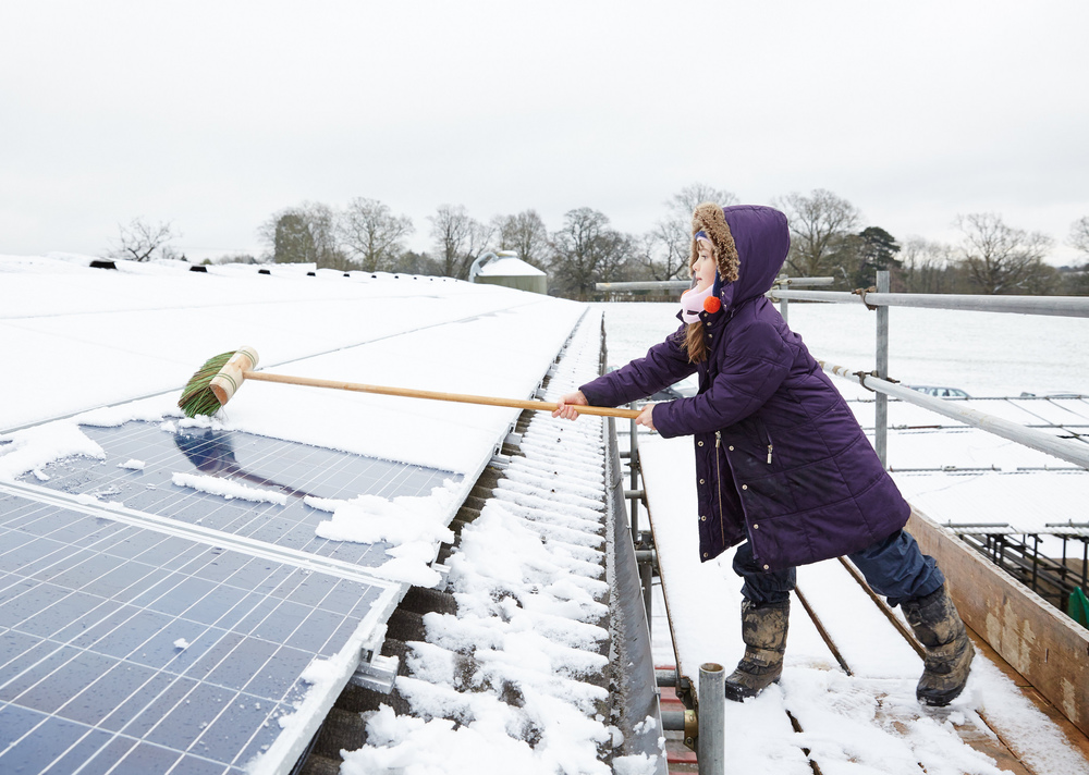 Snowy solar panels at RepowerBalcombes first site, Grange farm,