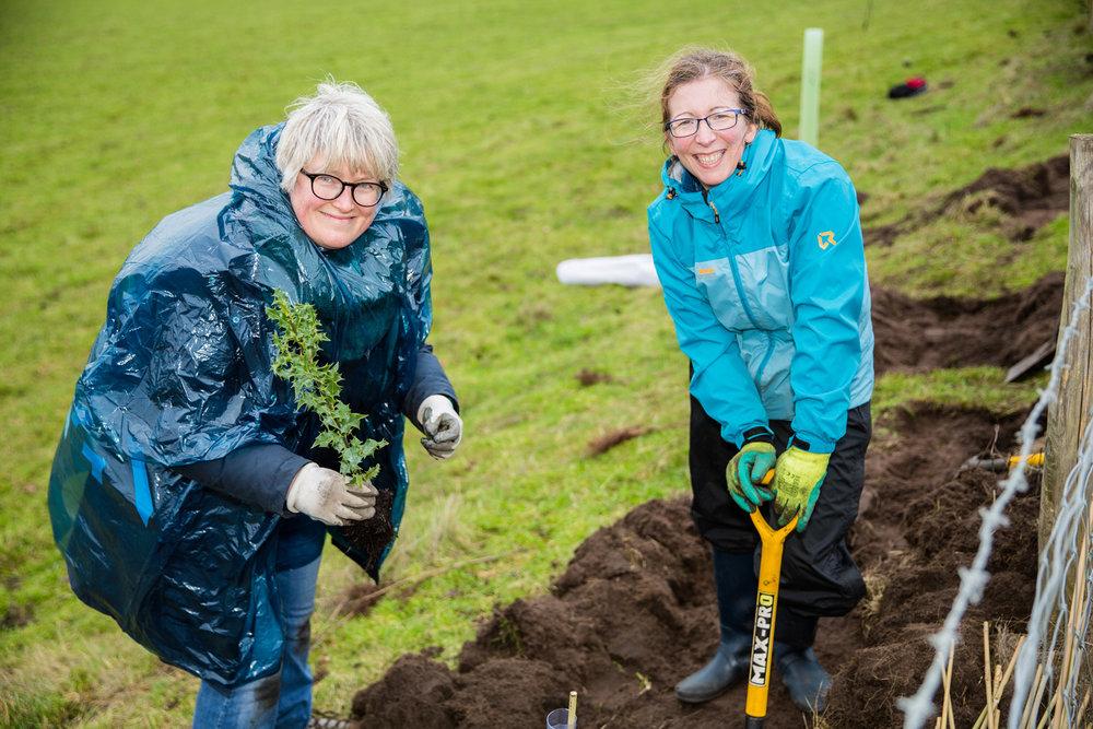 women-planting-smiling.jpg