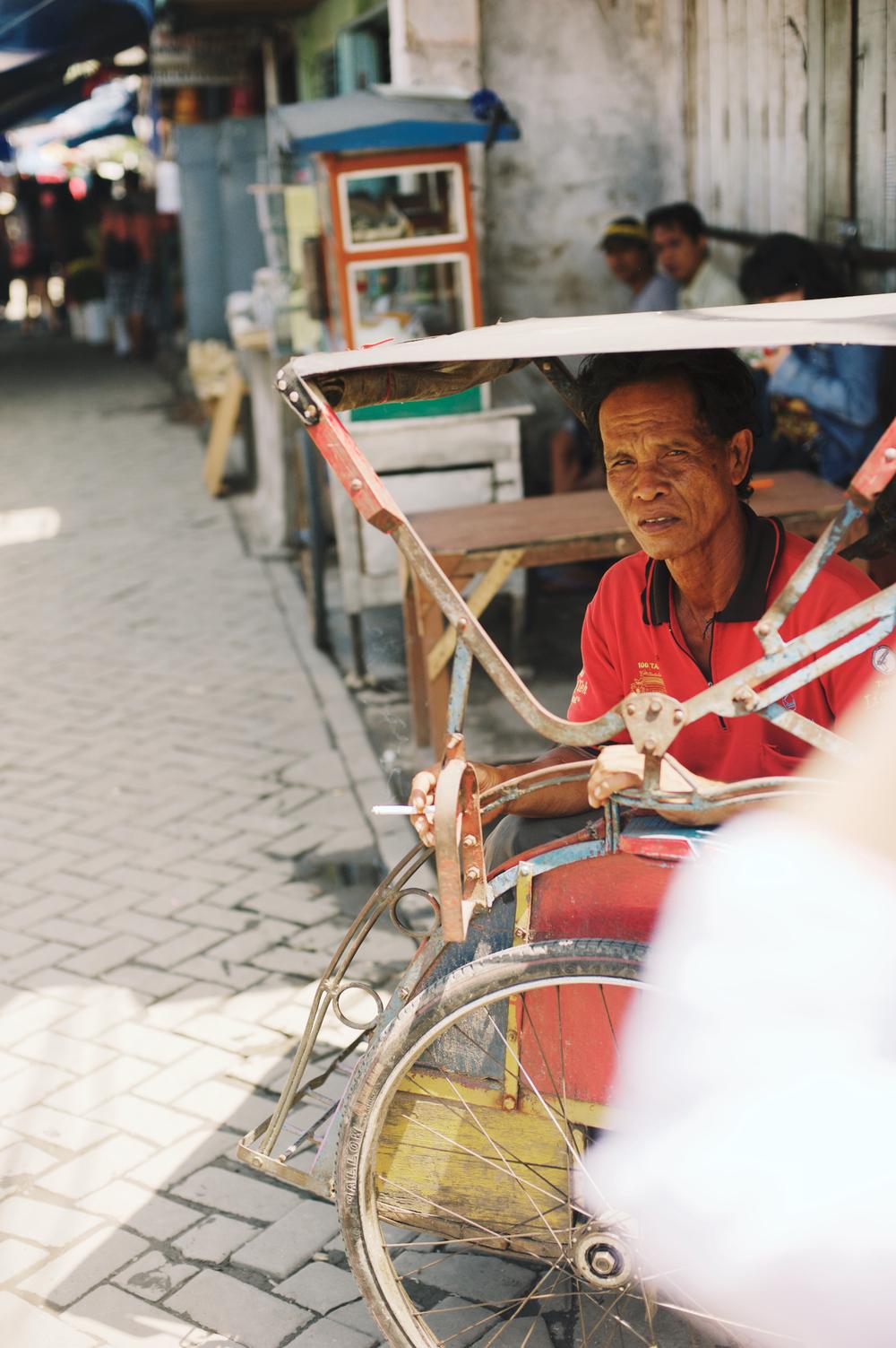 Indonesian market seller jakarta covered cart travel
