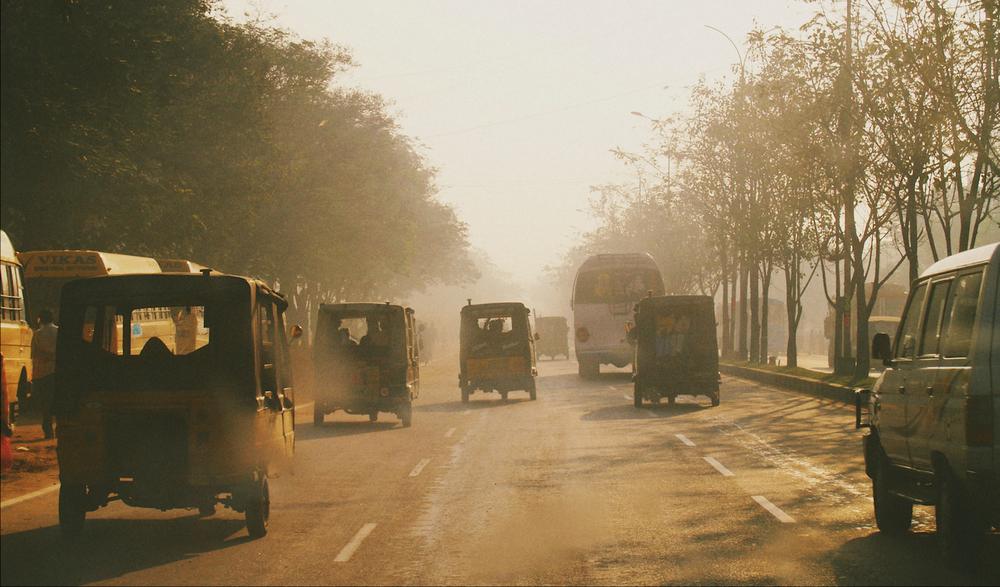 morning sunrise pollution haze hyderabad india tuktuk traffic
