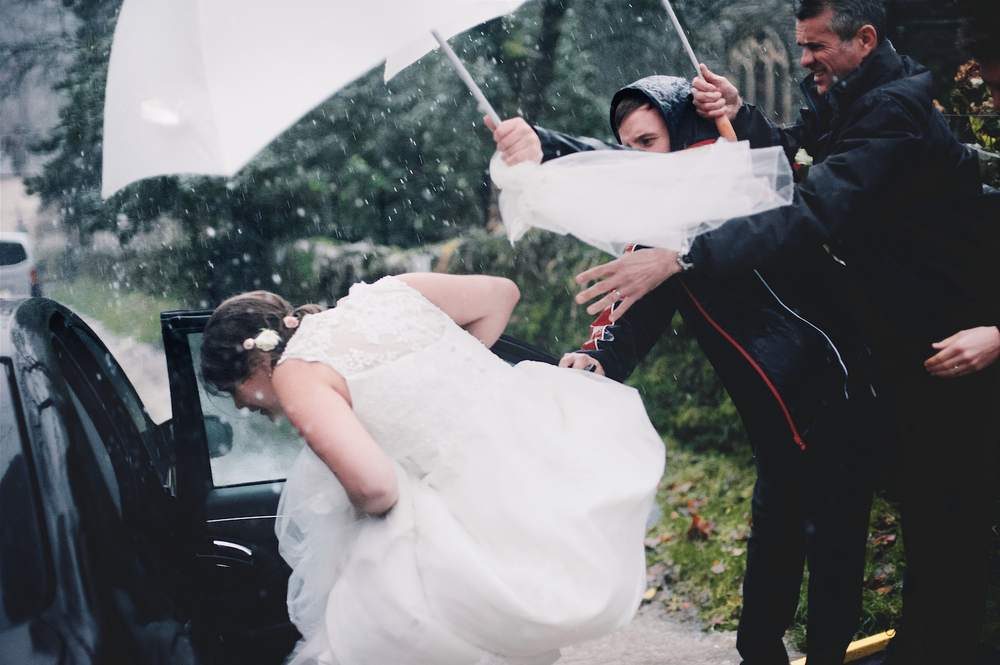 Wedding bride storm desmond heavy rain lake district rydal hall