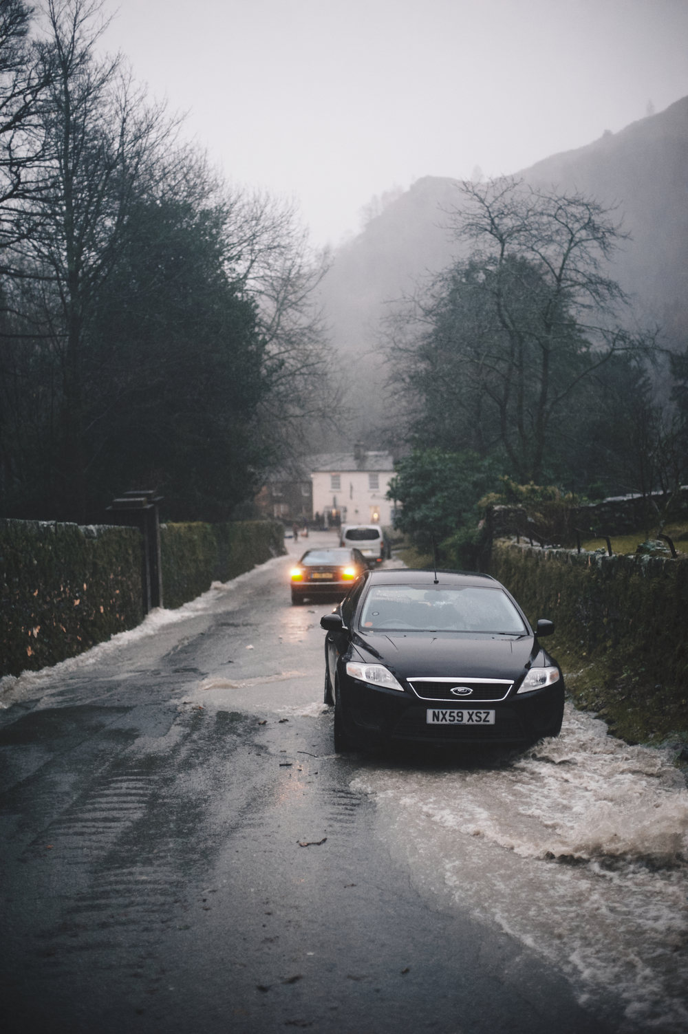 wedding cars in floods roads rydal hall lake district