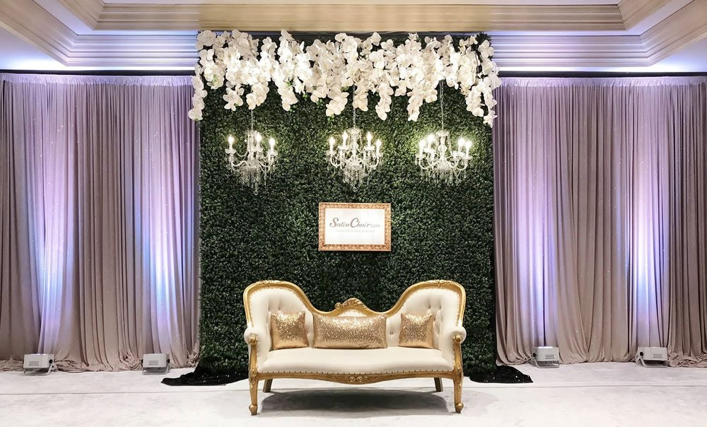 Greenery Wall Backdrop with Chadeliers, Floral and Sofa.jpg