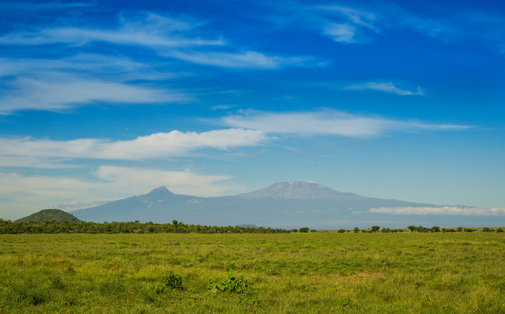 In shadow of Mt Kilimanjaro, Amboseli is a vast canvass