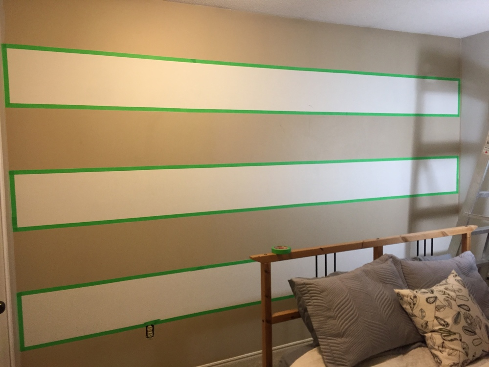I taped off the edges of the existing white stripe to protect them from the new grey paint.