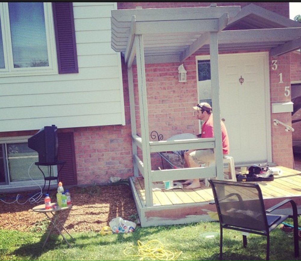 Painting the front deck a few years ago-- yes, that is a TV in the flower bed.