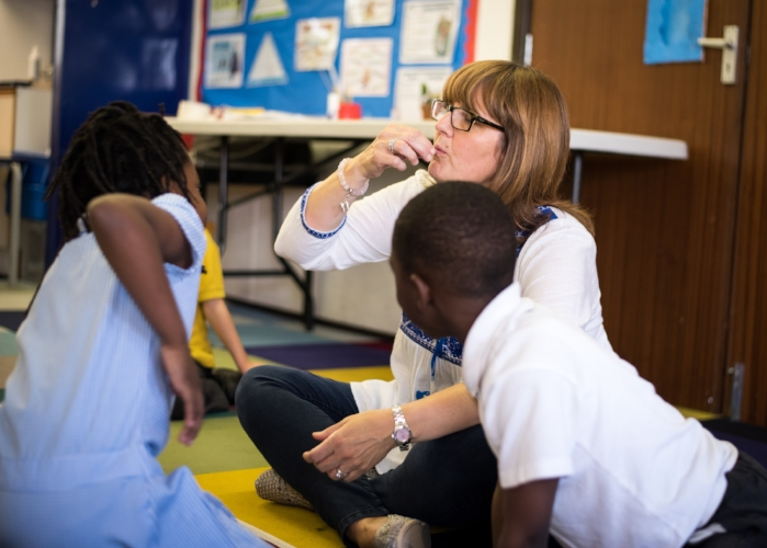 Teaching Assistant, Shelly Bergh, acting out her children's stories at St John's School, Walworth