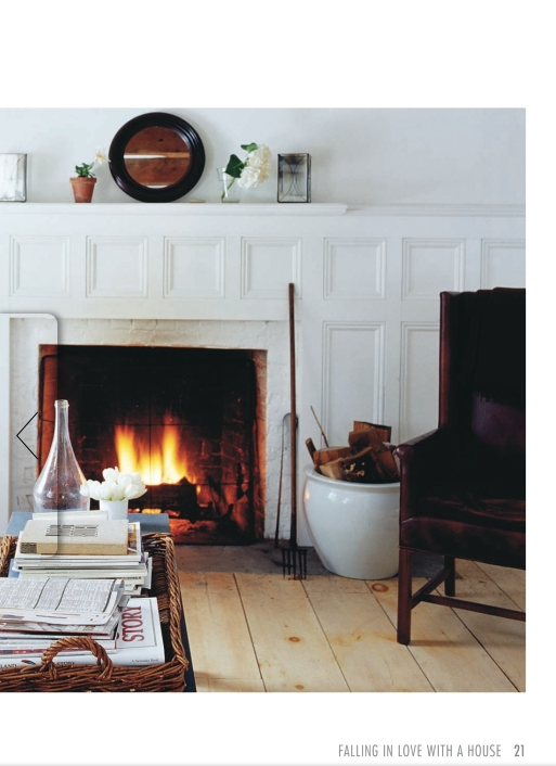 The real wood burning fireplace, the scrubbed antique pine floors, the sturdy leather arm chair and the basket filled with reading material make me want to crawl inside this photo.