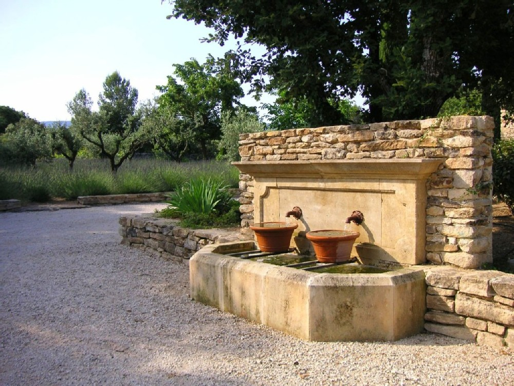 Pea gravel, rustic fountains and sunshine.  Heavenly.