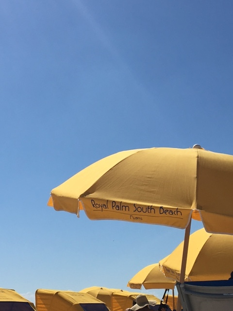 The Bright Yellow Umbrellas against the Cerulean Blue Sky