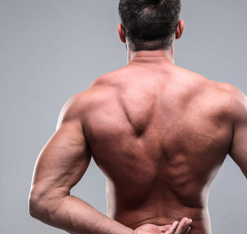 back-pain-injury-on-fit-adult-man_SFzW761RSo.jpg