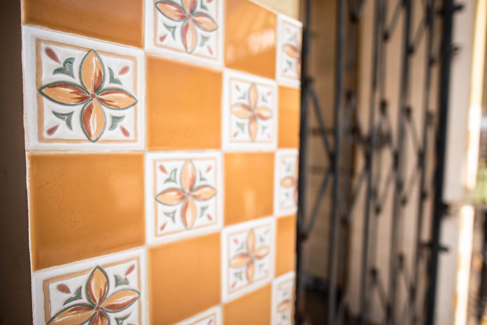 Inviting tiles beside an unwelcoming barred doorway