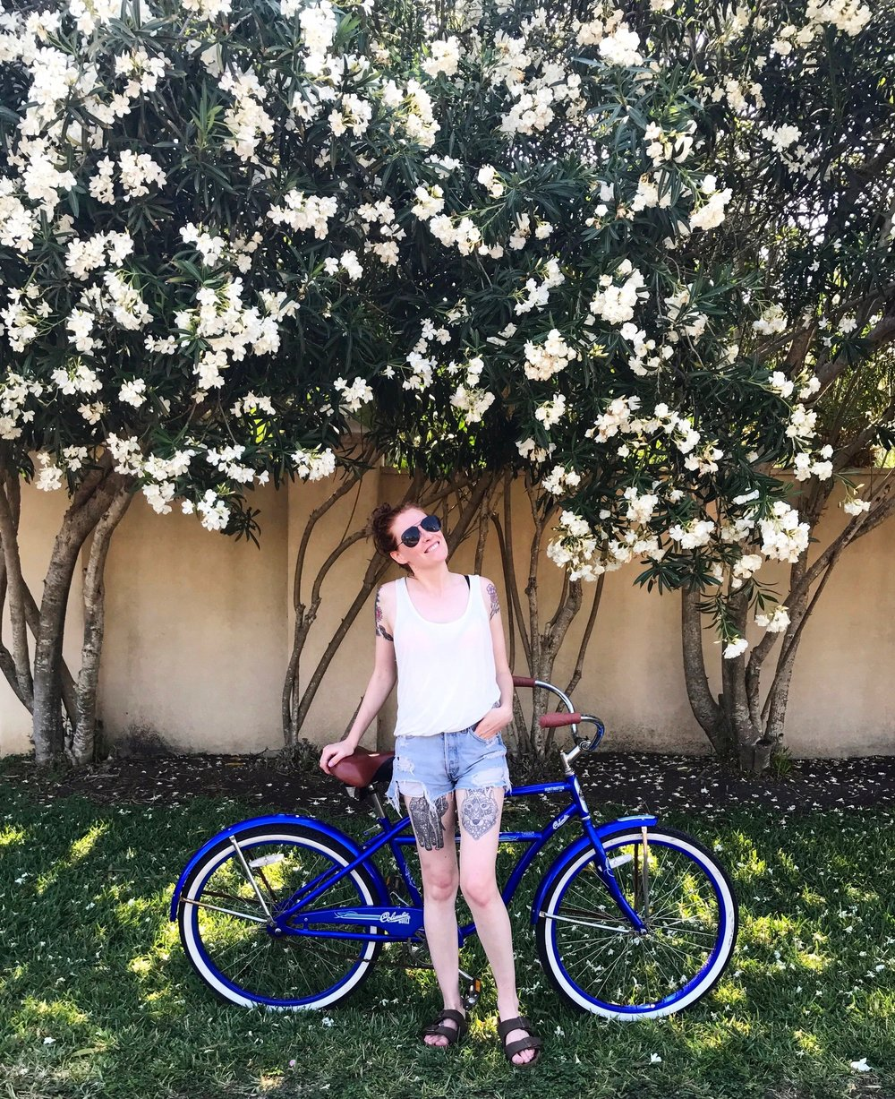 Posing with my trusty bike and some Oleanders.