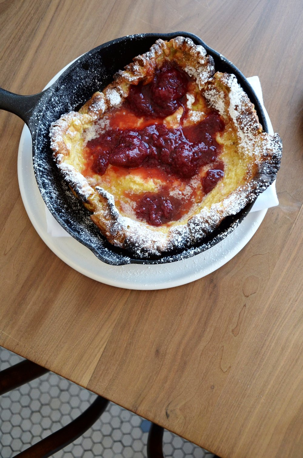 Dutch Baby - strawberry preserve, almonds and whipped creme fraiche.